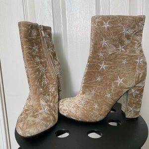 Star ankle boots.